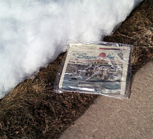 Shopping News rotting along a Ephrata sidewalk